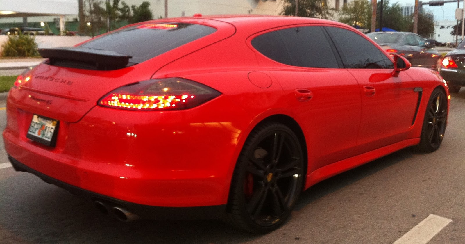 red porsche panamera with black rims dark tint design district miami fl