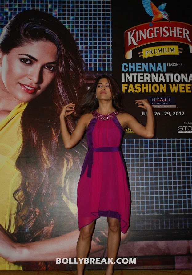Parvathy omanakuttan looks chic in a pink sleeveless dress with purple cinch at waist -  Parvathy Omanakuttan Pink dress photos