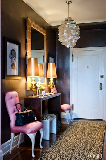 black walls in foyer with pop of hot pink and leopard