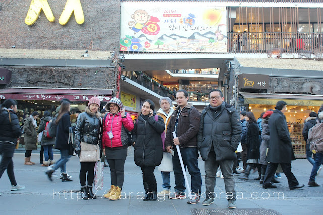 Filipino migrants at the busy street of Insadong