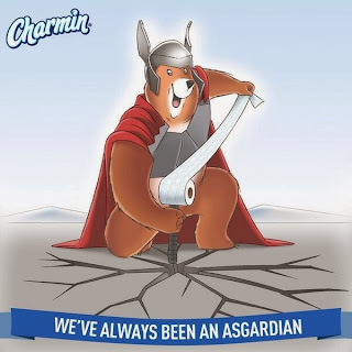 cartoon bear dressed as thor, cracking the ground with a sword that has a toilet paper roll at the end.