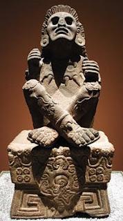 Xochipilli de piedra con papalotl