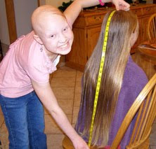 A girl donating her hair to Locks of Love