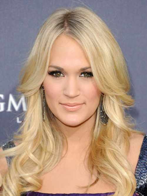 Carrie Underwood a simple center part and gorgeous blonde curly layers Hairstyle.