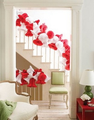 [An interior with red and white paper bells]