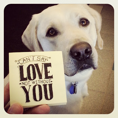 "Sweet photo of Griff looking adoringly at the camera with one of JR's post-its that reads ""Can't say love, not without you."""