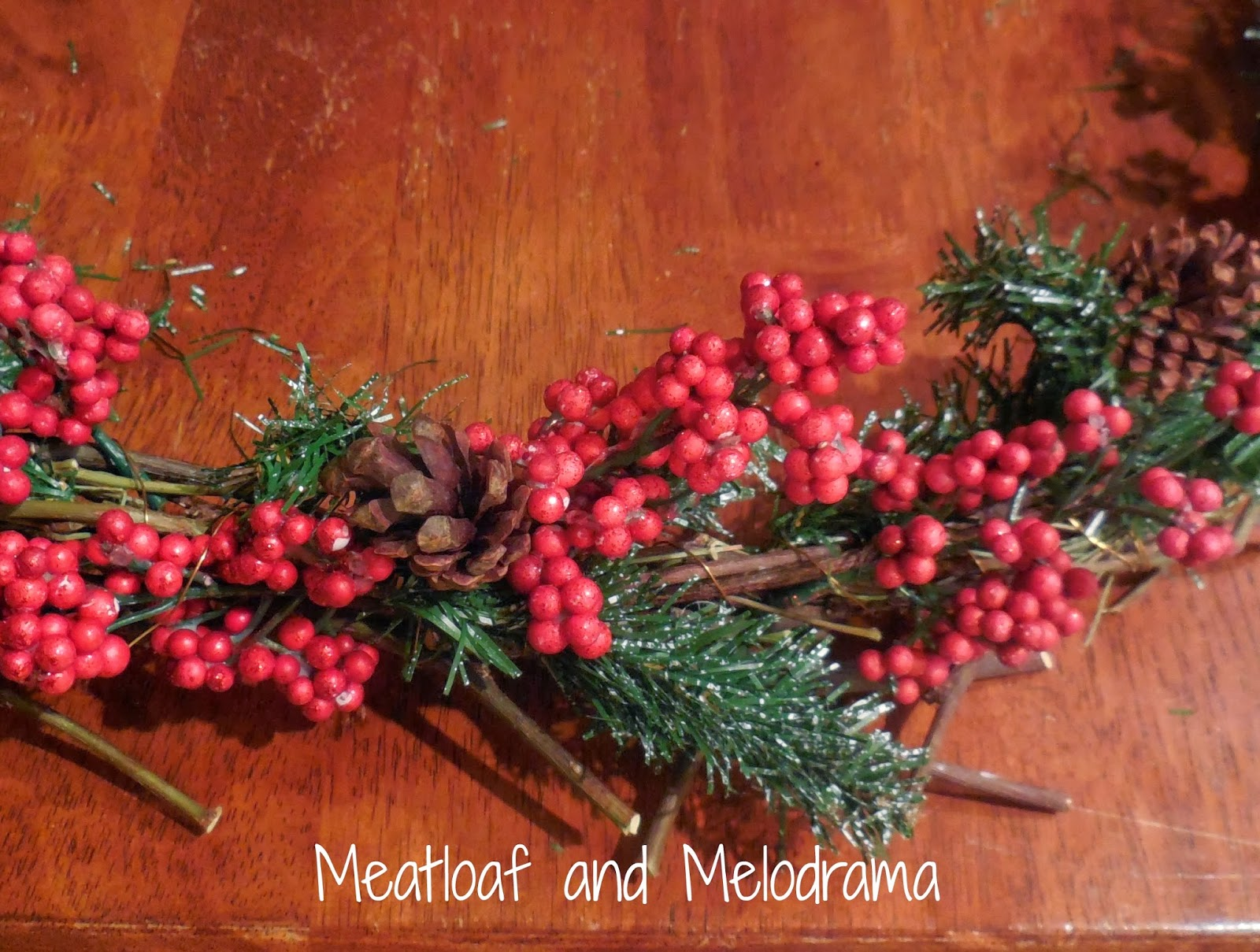 pine cones and berries on wreath