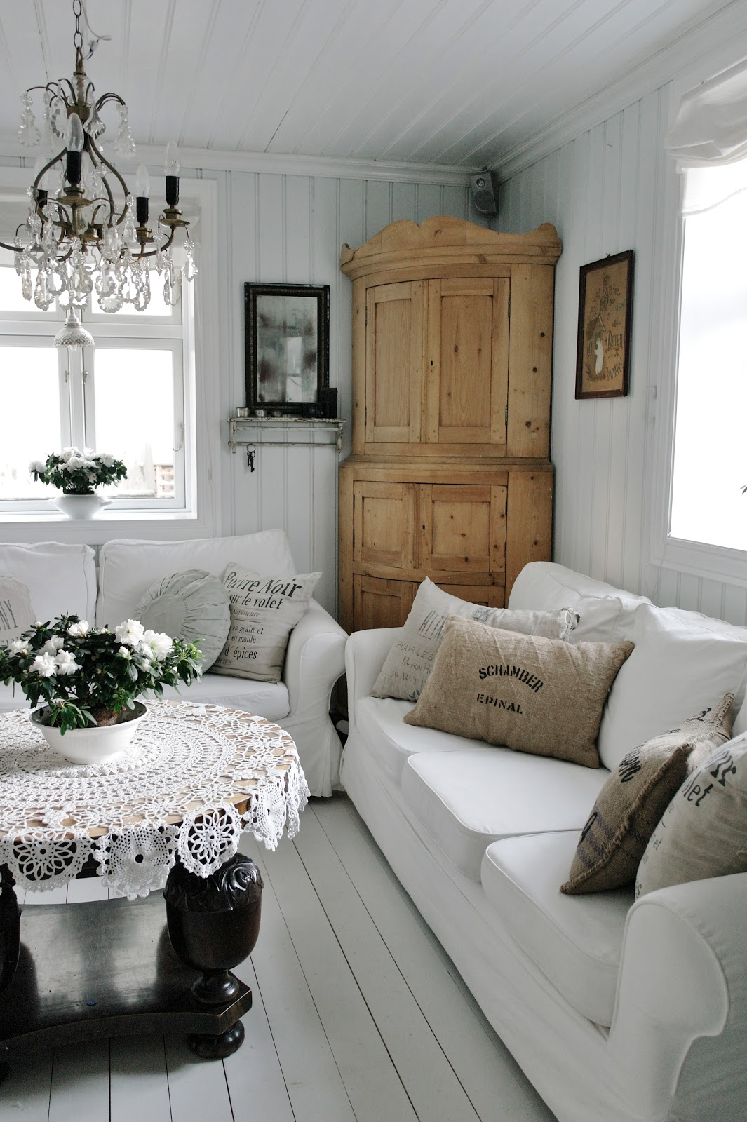 Love the barnwood shelves wall behind the sofa for Cottage style family room