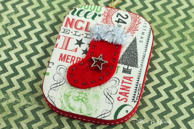 Make a vintage-inspired ornament complete with tiny felt stocking from a paper mache ornament!  Tutorial by Pitter and Glink