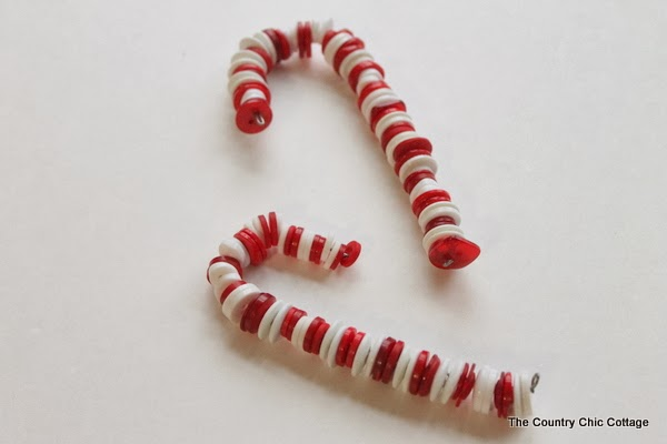 Button Candy Cane Christmas Ornaments -- handmade ornament tutorial that will have your tree full of button candy canes in no time.