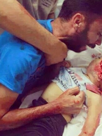 Palestinian father cries over four-year-old son killed in Israeli airstrike in Gaza