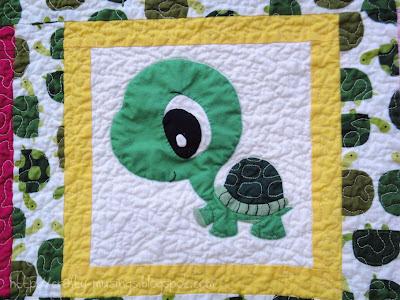 appliqued turtle mascot