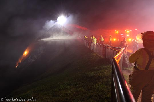 Late night fire on Te Mata Peak, on the face nearest Craggy Range Winery, just down from the hang-glider, paraglider launching pad at the top. photograph
