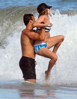 Avril Lavigne in wet bikini top and blue shorts having fun2