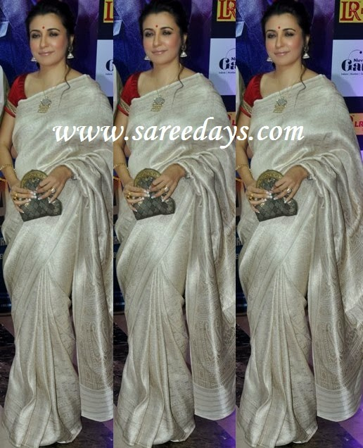 Latest saree designs mini mathur in off white raw silk saree checkout mini mathur in off white raw silk saree with shimmer work all over the saree and paired with contrast short sleeves red blouse altavistaventures Image collections