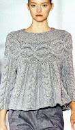 Sweter con trenzas