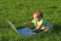 This is a picture of a baby using the internet, showing if children should be allowed on the web