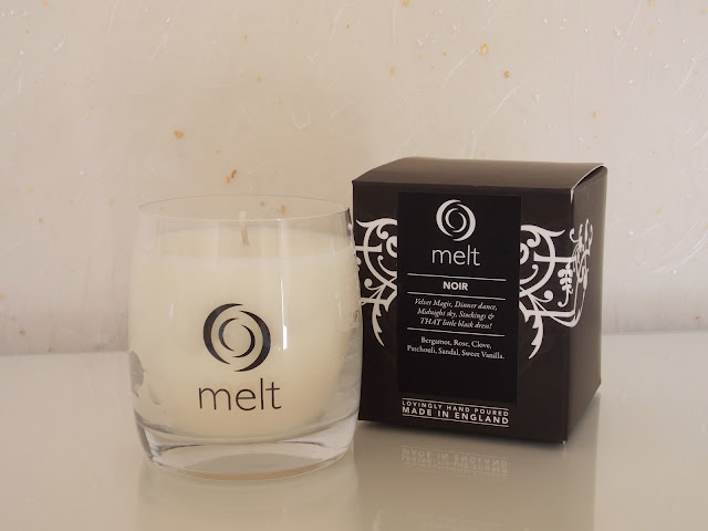 A Melt Scented Candle, pictured against a pale background in daylight