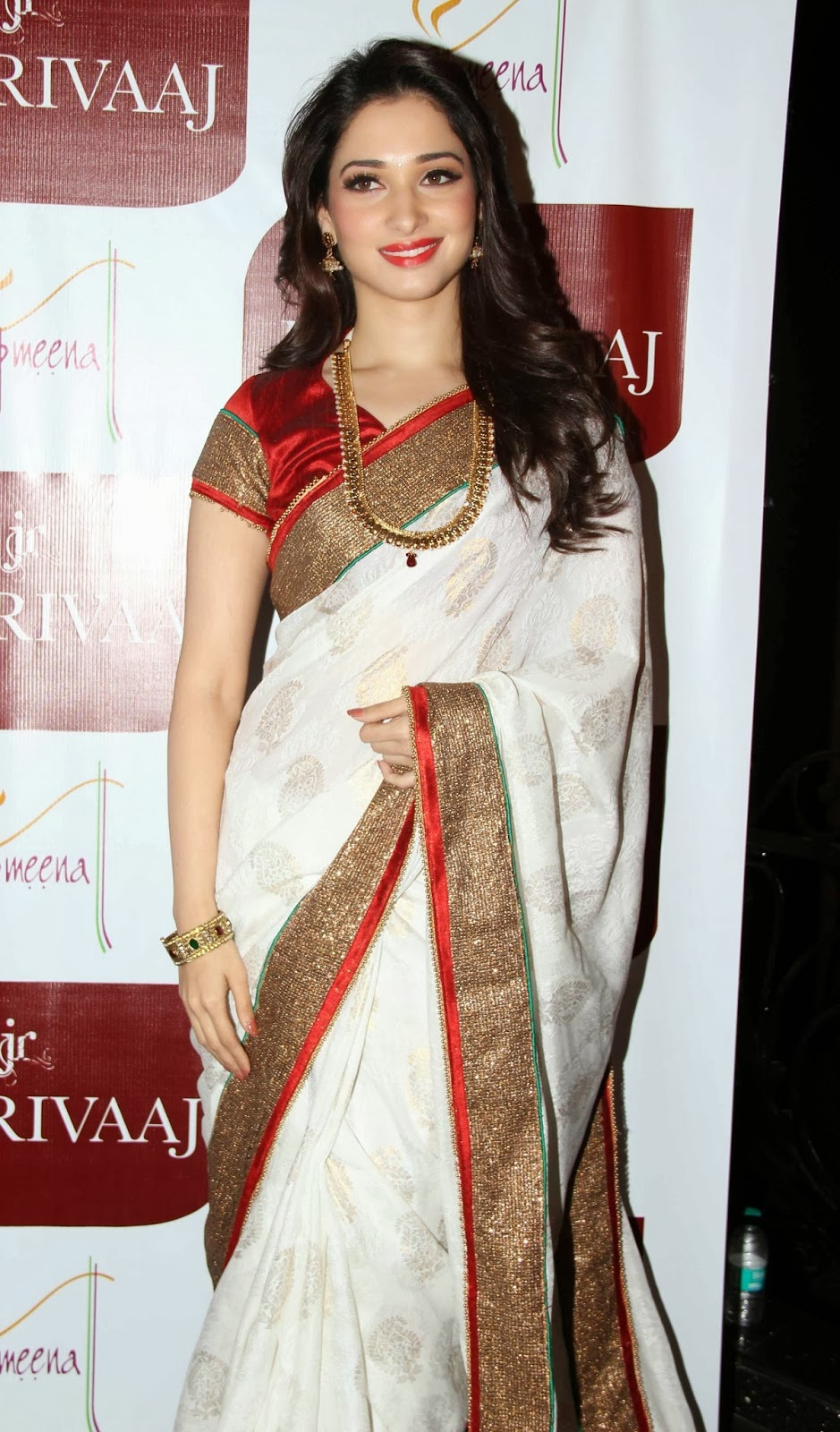 Tamanna hot pictures in white saree for jewellery ads ...
