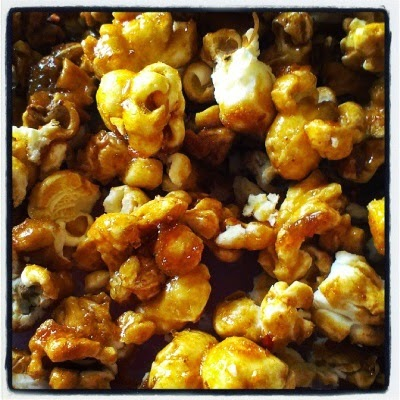 Popcorn enrobed in golden caramel coating.