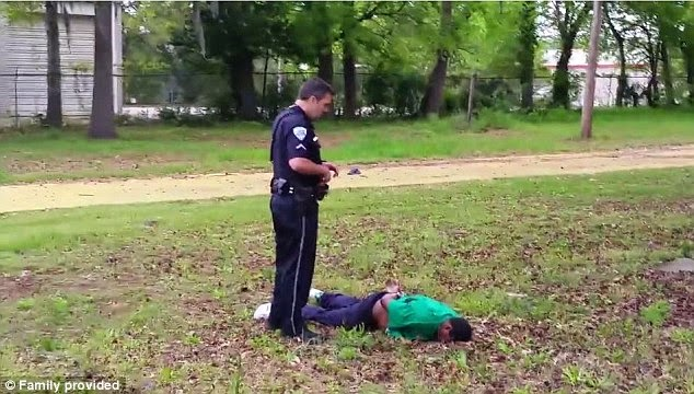 White cop shoots unarmed black man 5 times in the back, handcuffs his lifeless body 275B693F00000578-3029597-image-a-27_1428452187597