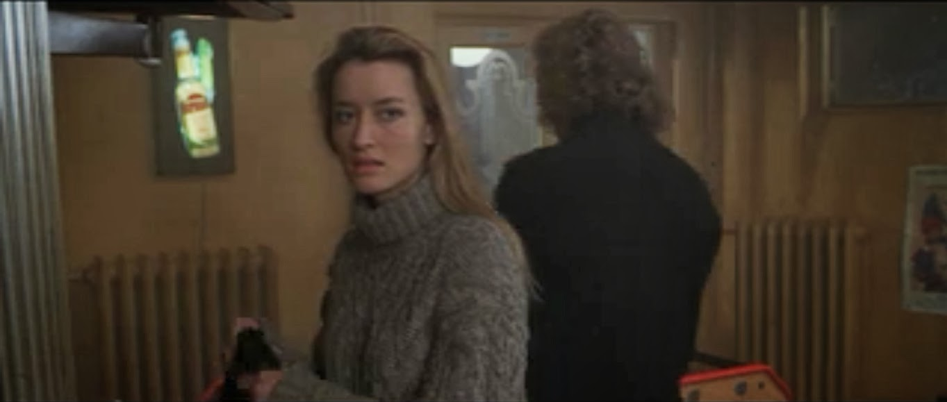 Natascha McElhone as the enigmatic and icy Irish lass Deirdre. Ronin, 1998. screenshot, sweater and overcoat, costume design - May Routh