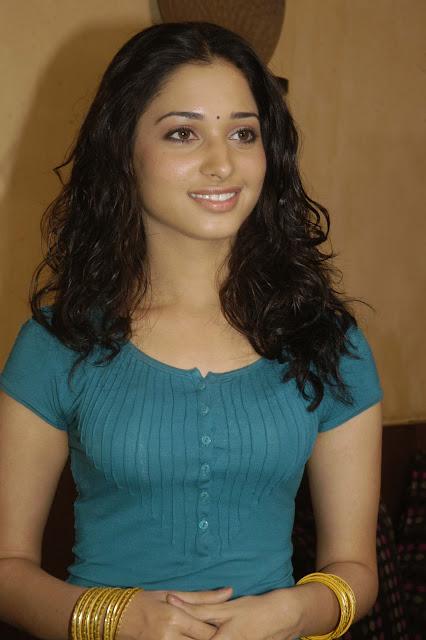 "Tamannaah Bhatia Displays Sexy Body In Blue Figure Hugging Top and Yellow Skirt At Telugu Film ""Konchem Ishtam Konchem Kashtam"" Press Meet"