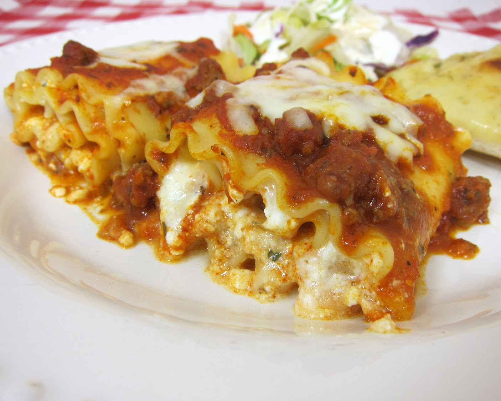 Lasagna Rolls Recipe - Lasagna noodles, topped with cheeses, rolled up ...