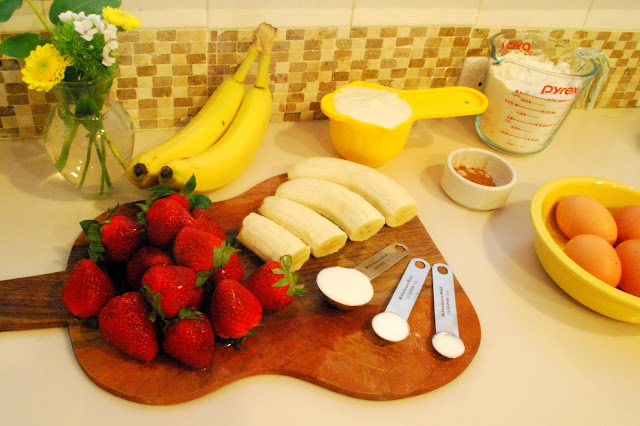 Flowers, fresh fruit, and pancake ingredients