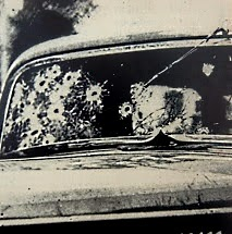 Bonnie's side of windshield/Death car.  Shots said fired by Frank Hamer  and Manny Gault??