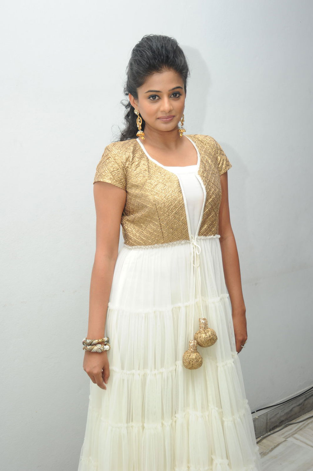 stylish Priyamani in golden dress latest photos at chandi movie trailer launch