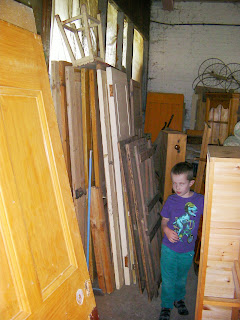 stacked doors and wooden objects for reclamation refurbishment