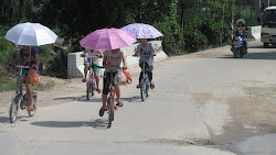 Girls, bikes, umbrellas.