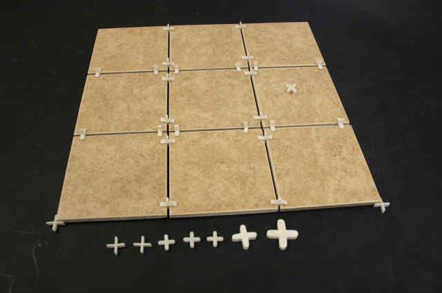 Here Is A Tile Installation In A Shower, Showing Spacers At The Corners Of  The Tiles, Keeping Them Equidistant.