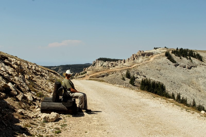 Papa stops to rest along the hike out to Medicine Wheel, Bighorn National Forest