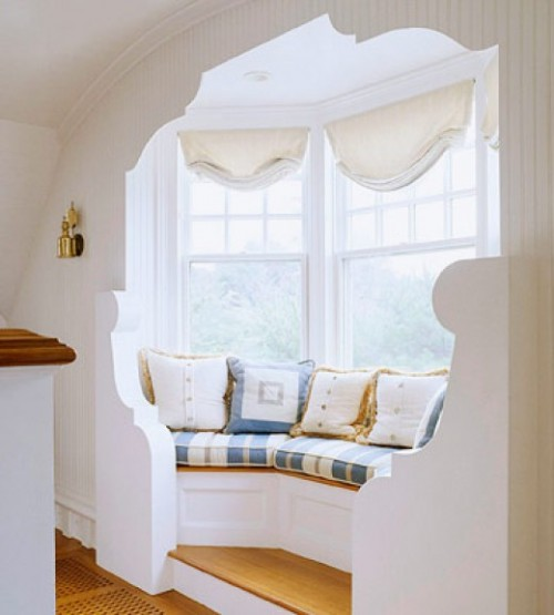 curved bench window seat content in a cottage