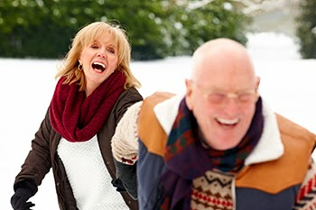 Photo of laughing elderly couple
