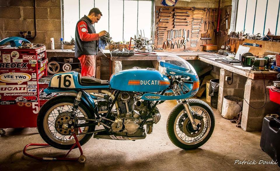Mercenary garage january 2015 for Garage moto scooter