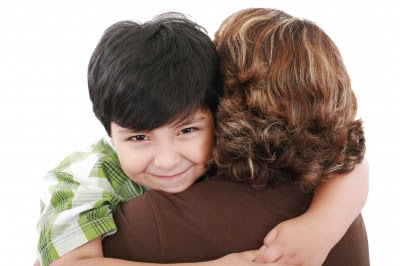 boy hugging mother NAMC montessori curriculum practical life activity mother&#39;s day ideas