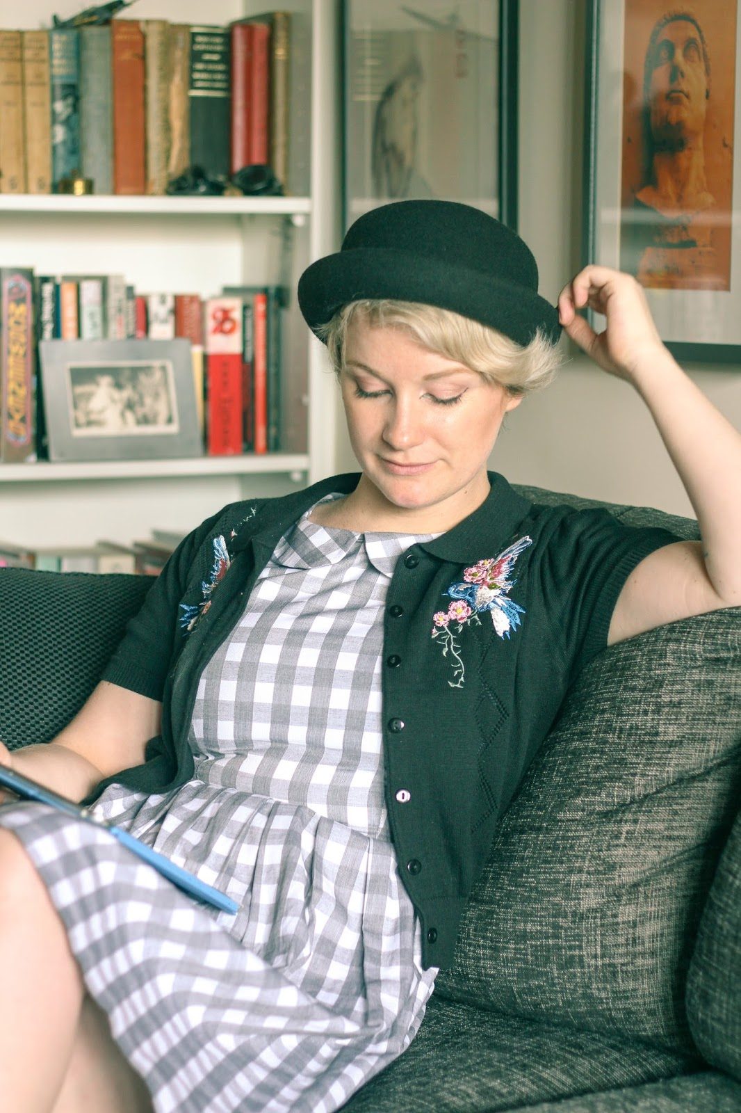 Liana of Finding Femme wears dangerfield gingham dress, princess highway embroidered bird cardigan, naturalizer shoes and black bowler hat.