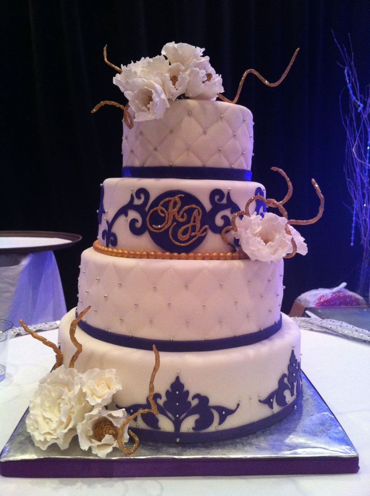 Delicious Delights NJ: White, Purple and Gold Wedding Cake