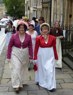 Sophie Andrews and Rachel Knowles taking part in  the 2015 Jane Austen Festival Regency  promenade © Andrew Knowles