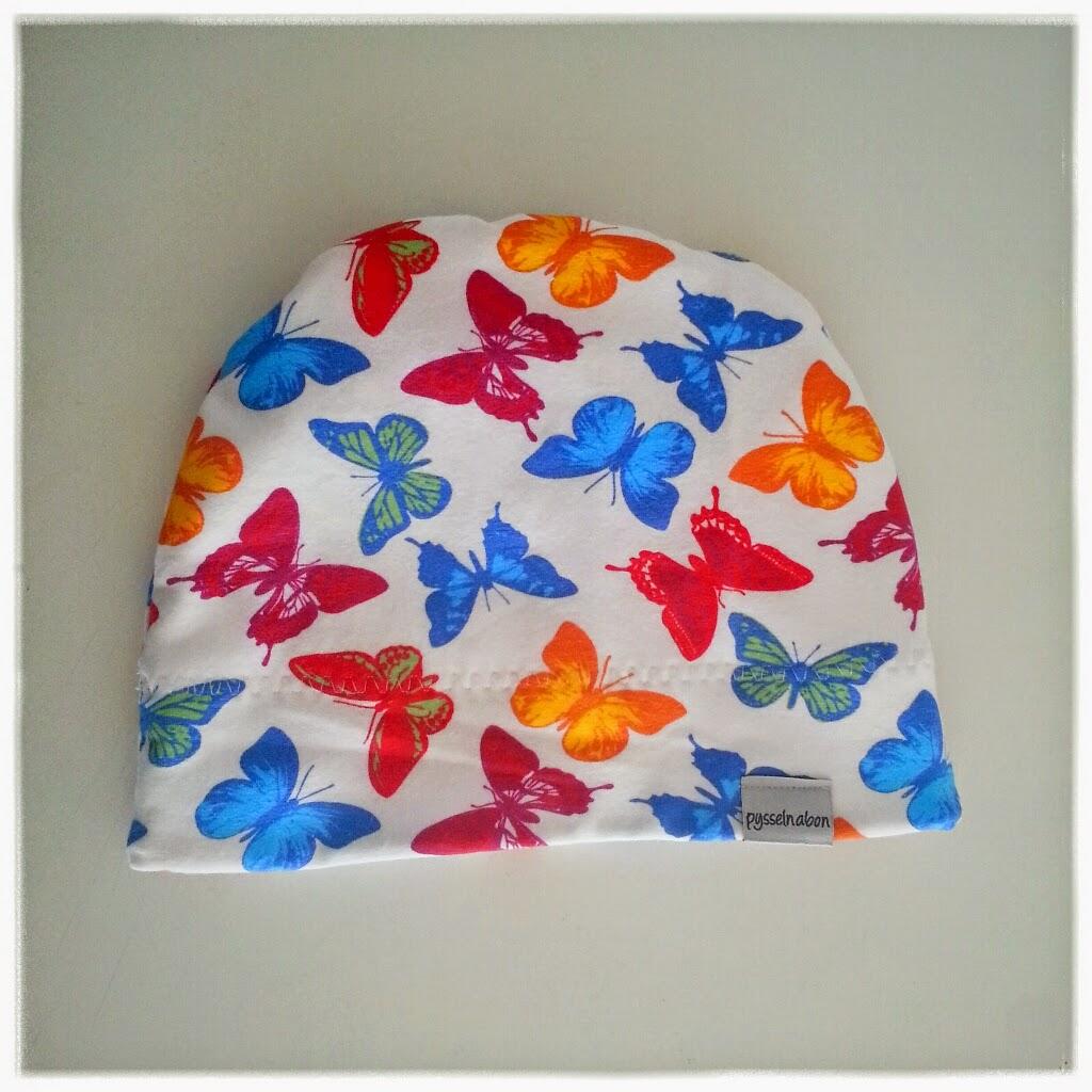 sy mössa fleece vinter höst fjärilar
