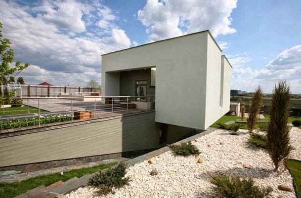 Fachada y dise o de casa moderna ubicada en la colina for Casa minimalista a desnivel