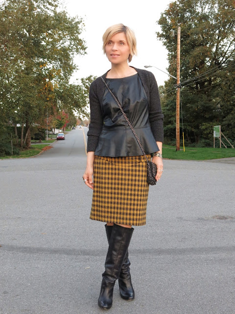 styling a plaid pencil skirt with a faux-leather peplum top, wool shrug, and knee boots