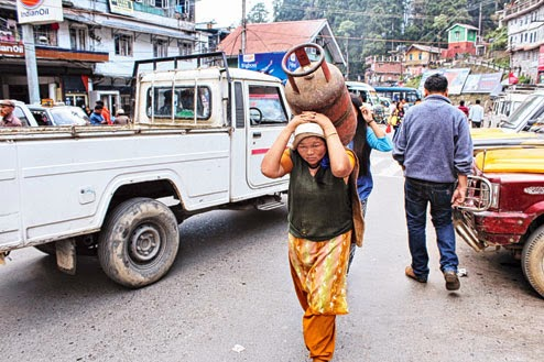 A woman porter carries goods in Darjeeling on Monday