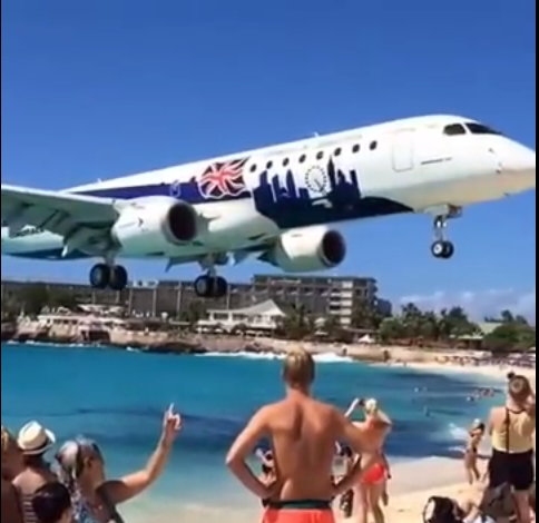 A Plane Flying On The Guys Its Really Amazing