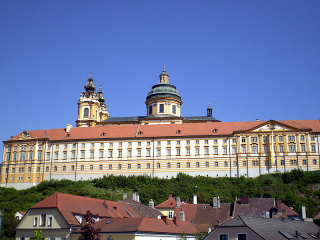 For nearly 1,000 years, the Melk Abbey still stands perched above its village below. Inside, treasures of all kinds await visitors who enter these hallowed halls. Photo: WikiMedia.org.