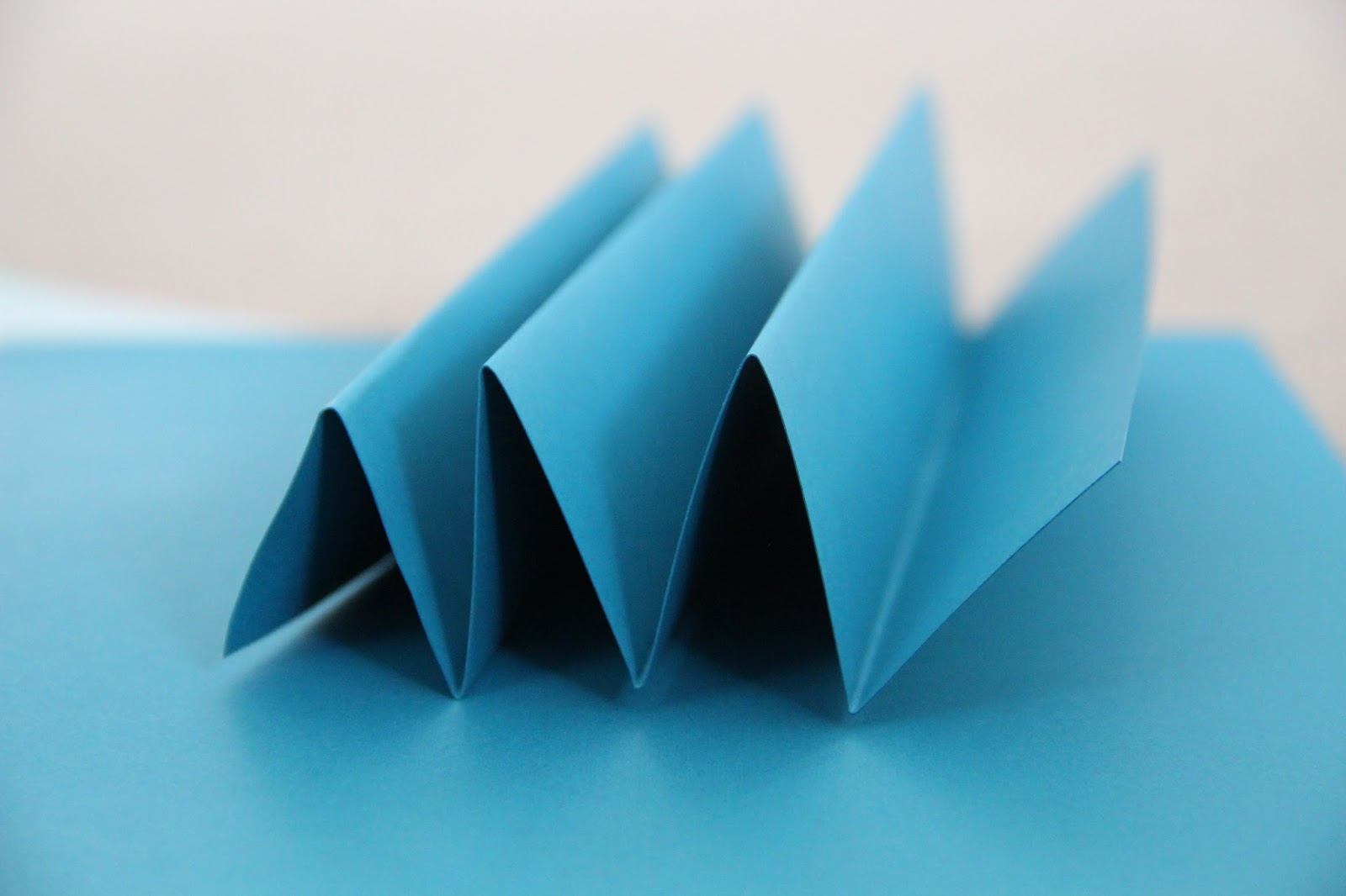 How to make rosettes out of paper - All You Ll Need Is A A Stack Of Card Stock Paper Hot Glue And Scissors I Found The Blue And Pink Card Stock At Michaels And To Make The Number Of