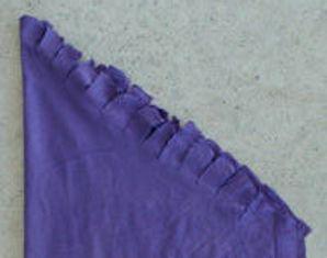 membuat suwar suwir pada sekeliling kain